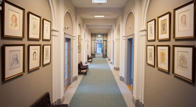 Hallway in the House of Representatives with portraits of all Presidents of the House