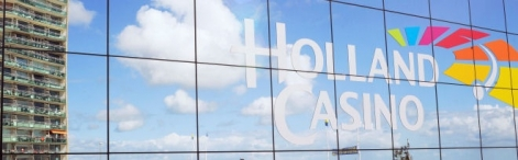 Reflection of the Holland Casinologo in glass
