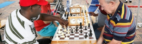 Two men playing chess on a chessboard