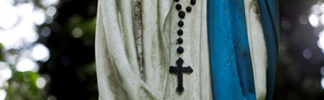 Statue of the Virgin  Mary, and a rosary
