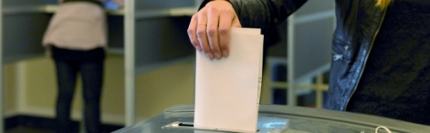 Putting the ballot paper in the ballot box